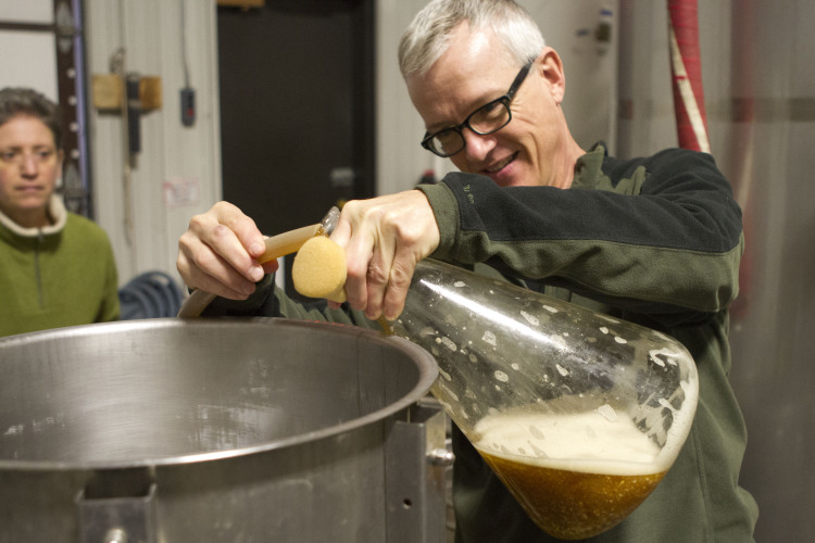 Rivertown Beer Evangelist Roxanne Westendorf and Rivertown Pilot Brewer Rob Westendorf adding Belgian Ardennes yeast to the Whiskey Shambles brew' Shambling Southward